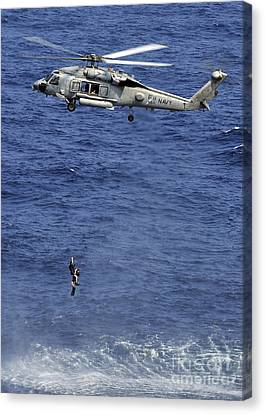 Search And Rescue Swimmers Canvas Print by Stocktrek Images