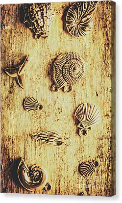 Seashell Shaped Pendants On Wooden Background Canvas Print