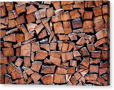 Seasoned Firewood Stacking Pattern Canvas Print by Frank Tschakert