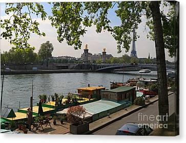 Seine Barges In Paris In Spring Canvas Print by Louise Heusinkveld