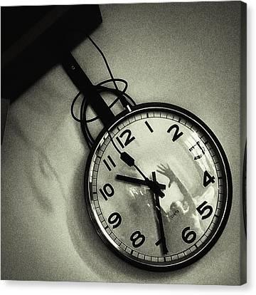 Selfportrait On A Clock Canvas Print