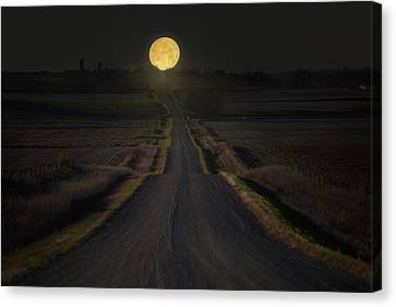 Setting Supermoon Canvas Print by Aaron J Groen