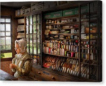 Sewing - Minding The Store  Canvas Print by Mike Savad