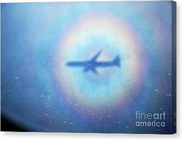 Shadow Of An Aeroplane Surrounded By A Rainbow Halo Canvas Print by Sami Sarkis