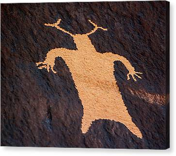 Shaman Figure At News Paper Rock Canvas Print by Gary Warnimont