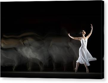 She in Motion Canvas Print by Andre Arment