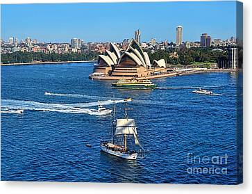 Ships And Boats Passing Opera House Canvas Print by Kaye Menner