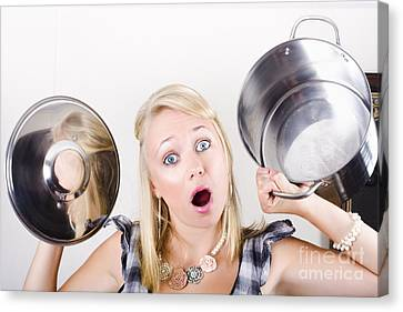Frenzy Canvas Print - Shocked Caucasian Woman Holding Empty Cooking Pot by Jorgo Photography - Wall Art Gallery