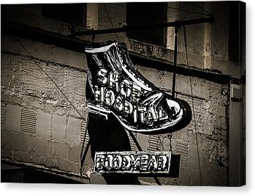 Shoe Hospital Canvas Print by Phillip Burrow