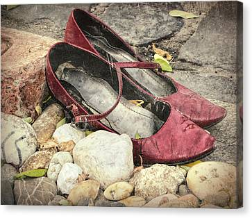 Shoes At The Makeshift Memorial Canvas Print by Joan Carroll
