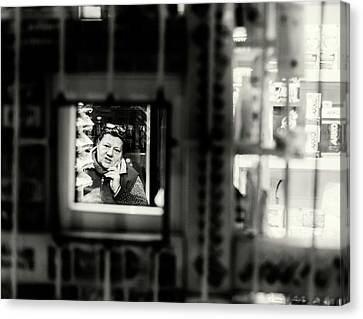 Canvas Print featuring the photograph Shopkeeper At Night by John Williams