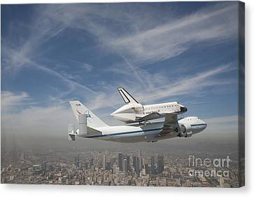 Shuttle Flying Over The City Of Los Angeles Canvas Print by Pd