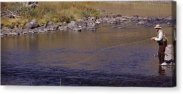 Side Profile Of A Man Fishing, Slough Canvas Print by Panoramic Images