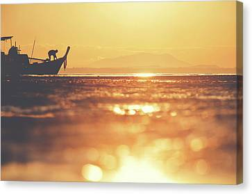 Silhouette Of A Thai Fisherman Wooden Boat Longtail During Beautiful Sunrise Canvas Print