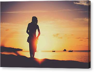 Srdjan Kirtic Canvas Print - Silhouette Of A Young Rasta Man Playing Drums On The Beach During Beautiful Summertime Sunset by Srdjan Kirtic