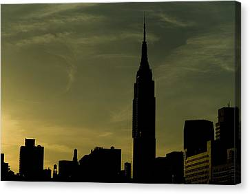 Silhouette Of Empire State Building Canvas Print by Todd Gipstein