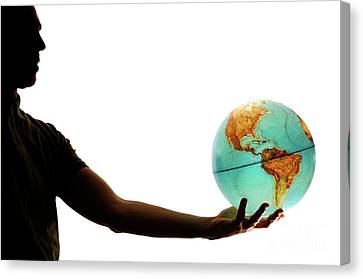 Silhouette Of Man Holding Globe Canvas Print by Sami Sarkis