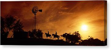 Silhouette Of Two Horse Riders Canvas Print by Panoramic Images