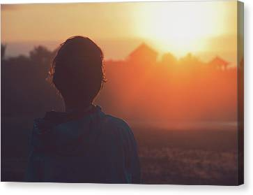 Silhouette Portrait Of A Young Woman With Short Hair Watching Beautiful Sunset Canvas Print