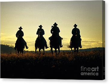 Silhouetted Cowboys Canvas Print by Inga Spence