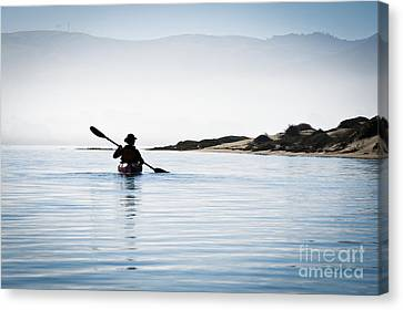 Silhouetted Kayaker In Morro Bay Canvas Print by Bill Brennan - Printscapes