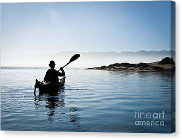 Silhouetted Morro Bay Kayaker Canvas Print by Bill Brennan - Printscapes