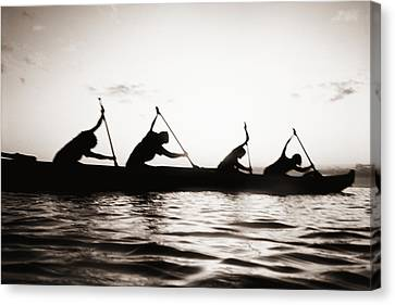 Silhouetted Paddlers Canvas Print by Bob Abraham - Printscapes