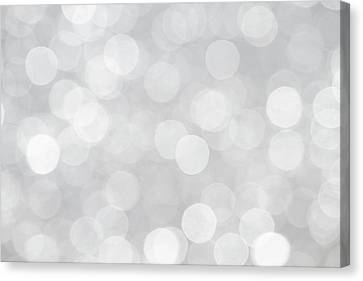 Silver Grey Bokeh Abstract Canvas Print by Peggy Collins