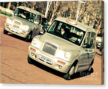 Silver London Taxi Cabs Canvas Print by Andy Smy