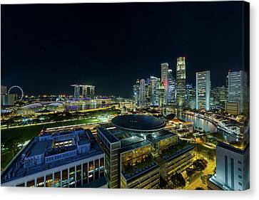 Singapore Modern Skyline By The River At Night Canvas Print by David Gn