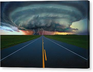 Single Lane Road Leading To Storm Cloud Canvas Print by Don Hammond