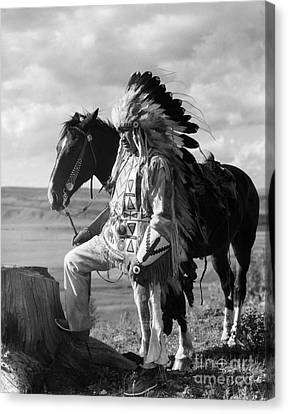 Native American Clothes Canvas Print - Sioux Man In Headdress With Horse by H. Armstrong Roberts/ClassicStock