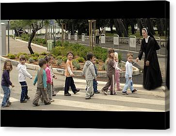 Sister Andrja Walking Her Students Canvas Print by Don Wolf