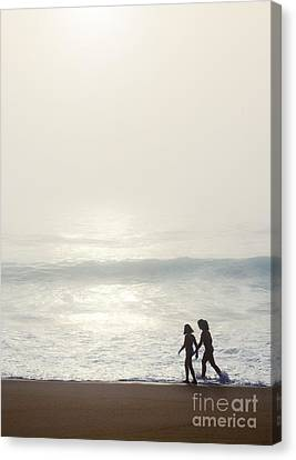 Sisters By The Seashore Canvas Print