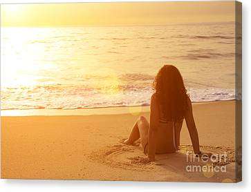 Sitting In The Sand Canvas Print