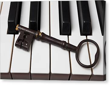Skeleton Key On Piano Keys Canvas Print by Garry Gay
