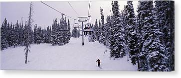 Ski Lift Passing Over A Snow Covered Canvas Print
