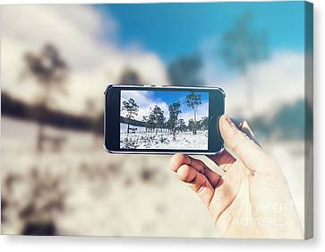 Ski Resort Tourist With Winter Landscape On Phone Canvas Print