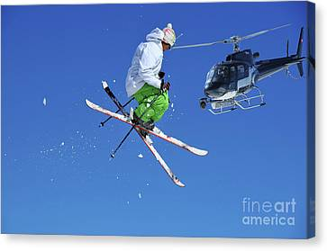Skier In Green And White Performing A Jump Canvas Print