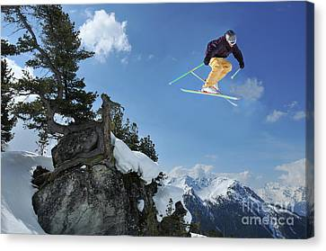 Skier Jumping From Rocks With An Arolla Pine Canvas Print