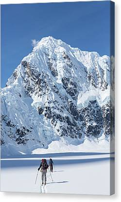Skiers And Shadows Canvas Print by Tim Grams
