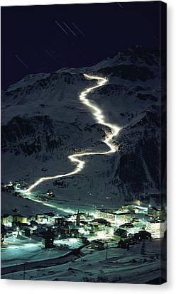 Skiers Bearing Torches Ski Down Mont Canvas Print by George F. Mobley