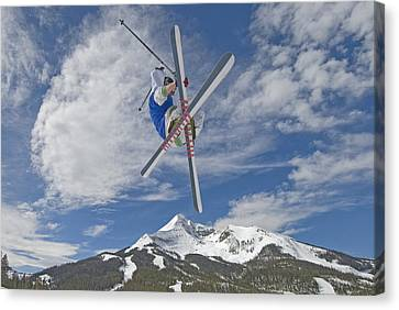 Skiing Aerial Maneuvers Off A Jump Canvas Print by Gordon Wiltsie