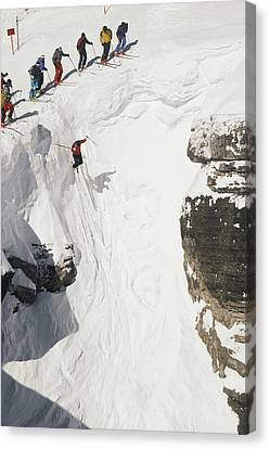 Skilled Skiers Plunge More Than 15 Feet Canvas Print by Raymond Gehman