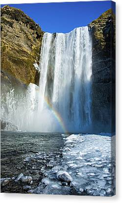 Canvas Print featuring the photograph Skogafoss Waterfall Iceland In Winter by Matthias Hauser