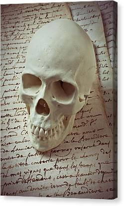 Human Head Canvas Print - Skull On Old Letters by Garry Gay