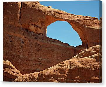 Canvas Print featuring the photograph Skyline Arch In Utah by Bruce Gourley