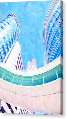 Skyscrapers Against Blue Sky Canvas Print by Lanjee Chee