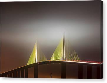 Skyway In Fog Canvas Print by Jon Glaser