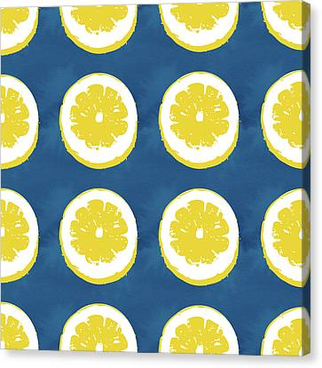 Sliced Lemons On Blue- Art By Linda Woods Canvas Print by Linda Woods